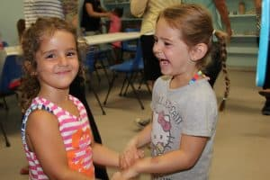 girls making friends at camp